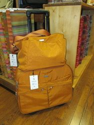 Baggallinni Gold Rolling Suitcase and Tote